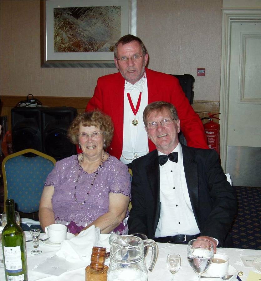 The President and his lady wife with Toastmaster Peter Collis